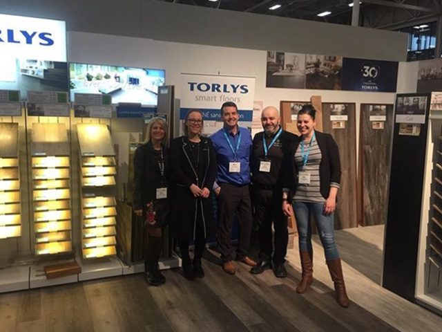 TORLYS employees at trade show