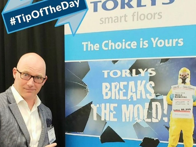 Andy with TORLYS advertisement banner